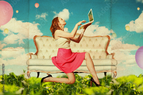 beautiful woman with book in clouds - 33607829