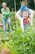 Gardening - little gardener with mother in vegetable garden