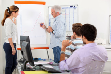 Man showing growth on a presentation board