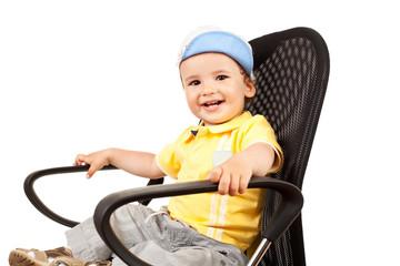 boy sitting on a black chair