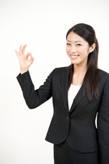 a portrait of asian businesswoman showing okay sign