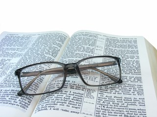 Bible Open with Spectacles