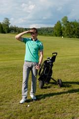 Men stay on green golf field