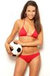 Pretty brunette woman in red bikini holding ball