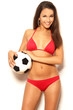 Sexy brunette woman holding ball in studio
