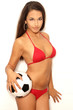 Pretty latina with ball in studio