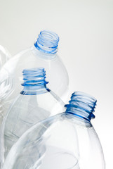 recyclable plastic bottles over white background