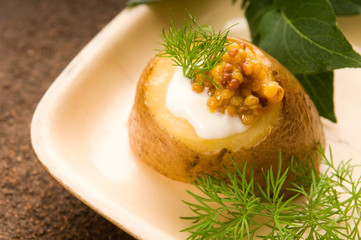 Baked potato with sour cream, grain Dijon mustard and herbs