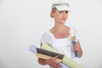 Female decorator preparing to wallpaper