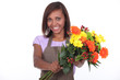 young black female florist taking a flowers bouquet