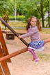 portrait of little girl having fun on seesaw