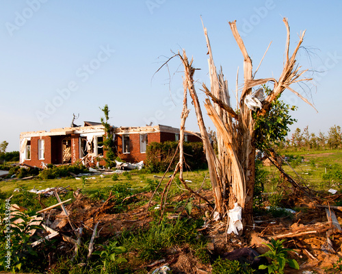 Tornado-damaged land and home in northern Alabama