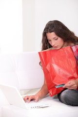 Woman purchasing products on-line