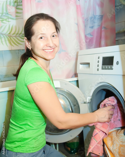 Mature woman doing laundry