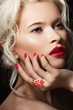 Blond model with fashion make-up, bright manicure & accessory