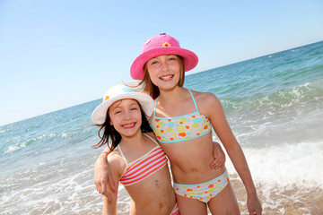 Happy little girls at the beach