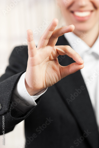 Women gesturing success sign