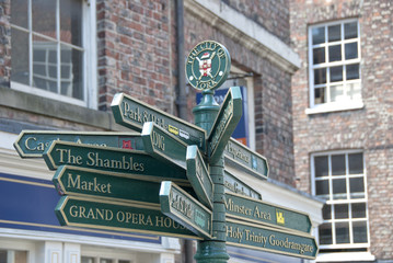 A necessity for tourists in York an ornate green street signpost