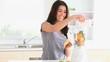Cute woman preparing a smoothie