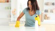 Young woman cleaning her kitchen