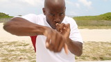Boxer punching towards camera in slow motion