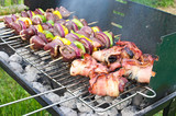 Shashlik with poultry hearts and bacon on grill poster