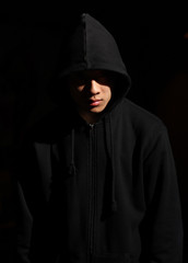 Monochrome picture of a guy in a hood