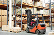 worker driver at warehouse forklift loader works