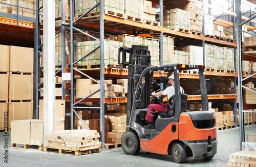 worker driver at warehouse forklift loader works