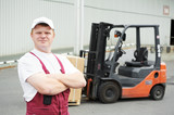 Fototapety warehouse worker in front of forklift