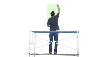 Artist painting on white wall