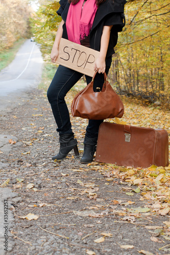 Hitchhiking the road, stop, handbag