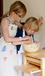 Children baking a cake