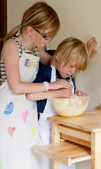 Children baking a cake