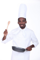 Chef with a pan and wooden spoon