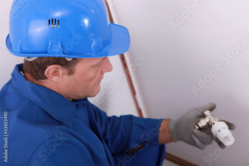 Plumber checking piece