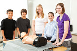Teenagers with CPR Training Mannequin poster