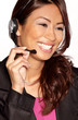 Portrait of pretty customer service worker with headset