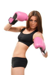 Beautiful young woman boxing pose in Pink gloves