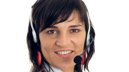 Pretty businesswoman with headset, isolated on white