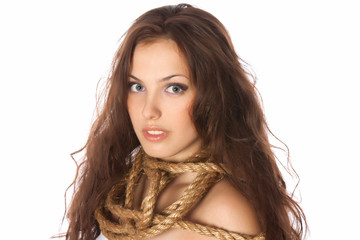 young red hair sensual woman trapped in rope wrapped on neck