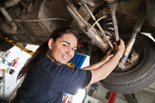 Portrait of smiling young female mechanic - 33658652