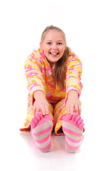 pretty sitting girl with pink striped sox, isolated on white