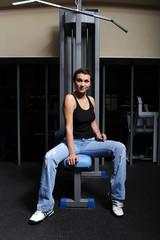 woman sitting near training equipment