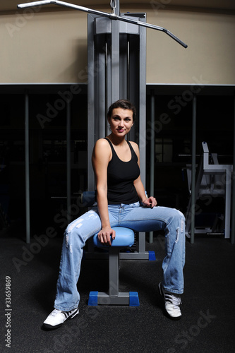 woman sitting near training equipment