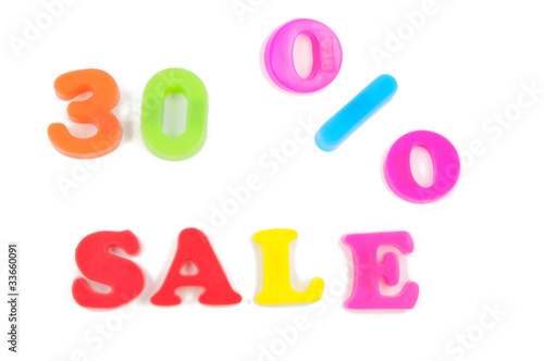 30% sale written in fridge magnets on white background
