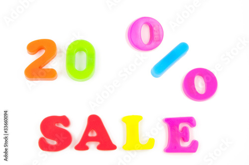 20% sale written in fridge magnets on white background