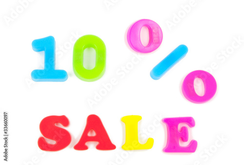 10% sale written in fridge magnets on white background