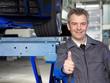 Master mechanic at work shows thumb up