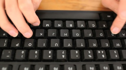 Female hands on a keyboard